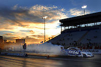 "Jan 20, 2007; Las Vegas, NV, USA; NHRA Funny Car driver Tommy Johnson Jr does a burnout during preseason testing at ""The Strip"" at Las Vegas Motor Speedway in Las Vegas, NV. Mandatory Credit: Mark J. Rebilas"