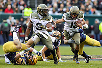 Philadelphia, PA - December 14, 2019:    Army Black Knights quarterback Christian Anderson (13) tries to break a tackle during the 120th game between Army vs Navy at Lincoln Financial Field in Philadelphia, PA. (Photo by Elliott Brown/Media Images International)