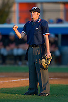Home plate umpire Tyler Wolpert indicates that the runner on third is out during an Appalachian League game between the Bluefield Orioles and the Burlington Royals at Burlington Athletic Park June 30, 2009 in Burlington, North Carolina. (Photo by Brian Westerholt / Four Seam Images)
