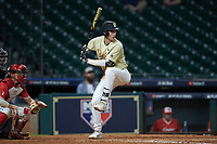 Connor Kaiser (12) of the Vanderbilt Commodores at bat against the Houston Cougars during game nine of the 2018 Shriners Hospitals for Children College Classic at Minute Maid Park on March 3, 2018 in Houston, Texas. The Commodores defeated the Cougars 9-4. (Brian Westerholt/Four Seam Images)
