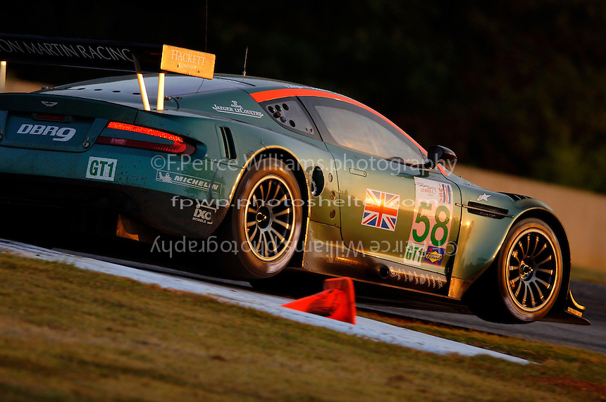 Tomas Enge catches some turn 3 air in the #58 Aston Martin...Copyright©F.Peirce Williams 2005.ref.Digital Image Only