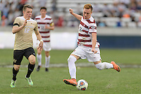 Houston, TX - Friday December 11, 2016: Corey Baird (10) of the Stanford Cardinal takes a long shot at the Wake Forest Demon Deacons goal with Brad Dunwell (12) attempting to block the shot at the NCAA Men's Soccer Finals at BBVA Compass Stadium in Houston Texas.