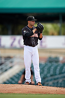 Jupiter Hammerheads starting pitcher Josh Roeder (12) looks in for the sign during a game against the Palm Beach Cardinals on August 5, 2018 at Roger Dean Chevrolet Stadium in Jupiter, Florida.  Jupiter defeated Palm Beach 3-0.  (Mike Janes/Four Seam Images)