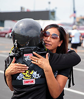 Aug 30, 2019; Clermont, IN, USA; NHRA top alcohol dragster driver Jasmine Salinas hugs mother Monica Salinas during qualifying for the US Nationals at Lucas Oil Raceway. Mandatory Credit: Mark J. Rebilas-USA TODAY Sports