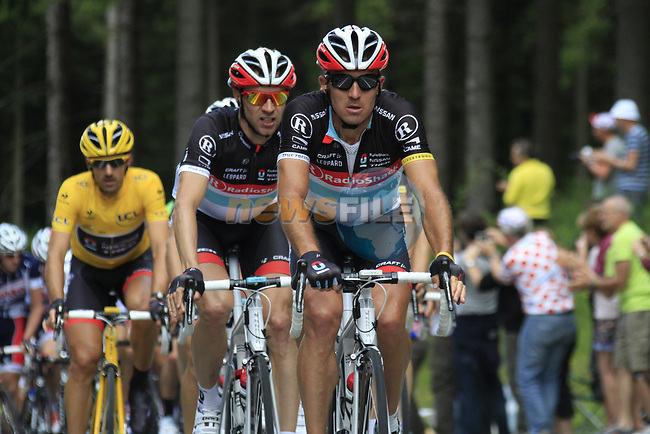 The peloton led by Yaroslav Popovytch (UKR), Jens Voigt (GER) and the rest of the Radioshack-Nissan team climbs the Cote de Francorchamps during Stage 1 of the 99th edition of the Tour de France, running 198km from Liege to Seraing, Belgium. 1st July 2012.<br /> (Photo by Eoin Clarke/NEWSFILE)