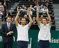 Rotterdam, The Netherlands. 16.02.2014. Michael Llodra(FRA)/Nicolas Mahut(FRA)(R)receive the winners trophy, left tournament director Richard Krajicek,  ABN AMRO World tennis Tournament<br /> Photo:Tennisimages/Henk Koster