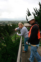 Home owner Esther Taylor speaks to Kevin Rogers of American Geotechnical Inc on the deck of her home just three homes up Mount Soledad Road from the crater left behind by the October landslide, January 21 2008.  Taylor received a bill from the San Diego Water and Wastewater Department for $6839.31 last Friday.