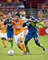 Houston Dynamo forward Brian Ching (25) holds off Seattle Sounders defender Jhon Kennedy Hurtado (34).  Houston Dynamo tied Seattle Sounders 1-1 on August 23, 2009 at Robertson Stadium in Houston, TX.