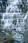 Waterfall, Glacier National Park, Montana, USA<br /> <br /> There are hundreds of waterfalls in Glacier National Park, some rushing all year, others drying to a trickle in the summer. Water cascades down steps of sedimentary rock, which make up the primary geology of the park.