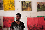 """Dickson Kaloki paints images of Nairobi's slums imbued with warm colors and a says """"these are places where people live and play."""" his work challenges the stereotypes of slums as frightening places."""