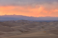 Great Sand Dunes National Park, Colorado.  I watched a wild sunset from high atop a dune.  While the clouds above me remained dark, the horizon lit up in a multitude of pink, purple, and orange hues.<br /> <br /> Canon EOS 5D Mk II, 70-200 f/2.8L lens