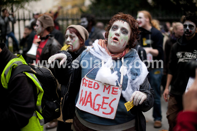 **ALL ROUND PICTURES FROM SOLARPIX.COM**                                             **NO UK NEWSPAPER PUBLICATION**.**UK MAGAZINE & SUPPLEMENT PUBLICATION ONLY** AND NO PUBLICATION IN AUSTRALIA, BELGIUM, FRANCE, GERMANY, ITALY, SCANDINAVIA AND USA**                                                                                  Occupiers from Occupy London held a flash mob dance protest, dressed as zombie bankers. .The demonstration began behind  St Paul's cathedral, before moving through the City of London..Picture shows: Protesters behind St Paul's cathedral                                                                           JOB REF:  14133      SFE       DATE:   31.10.11                                                         **MUST CREDIT SOLARPIX.COM OR DOUBLE FEE WILL BE CHARGED**                                                                      **MUST AGREE FEE BEFORE ONLINE USAGE**                               **CALL US ON: +34 952 811 768 or LOW RATE FROM UK 0844 617 7637**