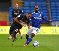 26th December 2020; Cardiff City Stadium, Cardiff, Glamorgan, Wales; English Football League Championship Football, Cardiff City versus Brentford; Bryan Mbeumo of Brentford is fouled by Junior Hoilett of Cardiff City