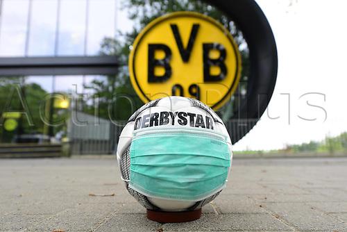 16th May 2020, Signal Iduna Park, Dortmund, Germany; Bundesliga football, Borussia Dortmund versus FC Schalke;  A Derbystar match ball with a protective mask lying in front of the Signal Iduna Park