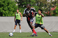 Tony Tchani (23) is marked by Irving Garcia (99) during a New York Red Bulls practice on the campus of Montclair State University in Upper Montclair, NJ, on July 16, 2010.
