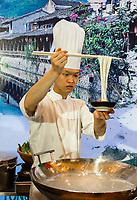 Wenzhou, Zhejiang, China.  Hotel Chef Demonstrating the Cooking and Serving of Noodles.