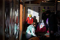 People put on snowboots in the rental building at Showdown Ski Area on King's Hill in the Little Belt Mountains near Neihart, Montana, USA.