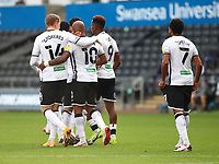 17th October 2020; Liberty Stadium, Swansea, Glamorgan, Wales; English Football League Championship Football, Swansea City versus Huddersfield Town; Swansea City players celebrate Andre Ayew of Swansea City penalty which tied the game 1-1 in the 33rd minute