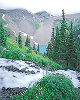 Alpine view of a casade above the lower Blue Lake in the Sneffels Wilderness area, Colorado.