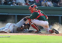 First baseman William Beckwith (23) of the Rome Braves is tagged out at the plate by catcher Jordan Weems (15) of the Greenville Drive in the sixth inning of a game on July 8, 2012, at Fluor Field at the West End in Greenville, South Carolina. Beckwith was trying to score on a double by Will Skinner. Greenville won, 12-3. (Tom Priddy/Four Seam Images)