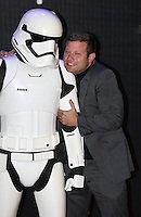 Dermot O'Leary with a Stormtrooper attends the STAR WARS: 'The Force Awakens' EUROPEAN PREMIERE at Odeon, Empire & Vue Cinemas, Leicester Square, England on 16 December 2015. Photo by David Horn / PRiME Media Images