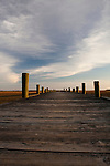 Long wooden dock during sunset lowcountry marsh grass old dock south carolina
