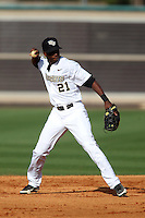 UCF Knights shortstop Darnell Sweeney #21 throws to first during a game against the Siena Saints at the UCF Baseball Complex on March 3, 2012 in Orlando, Florida.  UCF defeated Siena 6-4.  (Mike Janes/Four Seam Images)
