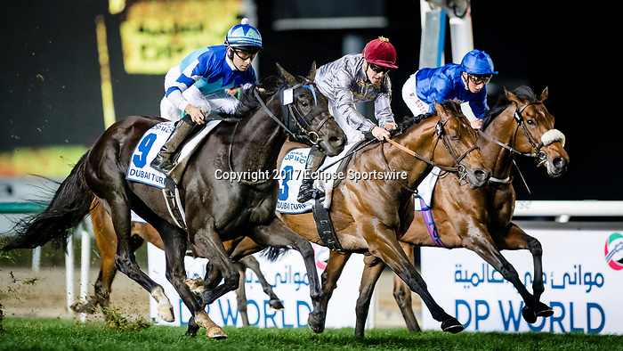 DUBAI, UNITED ARAB EMIRATES - MARCH 25: Vivlos #9 ridden by Joao Moreira (blue hat), wins the Dubai Turf at Meydan Racecourse during Dubai World Cup Day on March 25, 2017 in Dubai, United Arab Emirates. (Photo by Douglas DeFelice/Eclipse Sportswire/Getty Images)