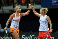 Arena Loire,  Trélazé,  France, 16 April, 2016, Semifinal FedCup, France-Netherlands, Doubles:  Hogenkamp (R) Bertens (NED) giving hi-five<br /> Photo: Henk Koster/Tennisimages
