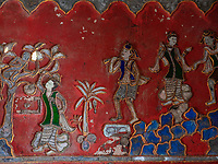 Monks at the Shwe Yan Pyay Monastery, made entirely out of Teak, near Inle Lake, Myanmar, Burma Intricate artwork on the walls in a building next to the Shweyanpyay teak wood Monastery