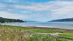 View north up Hood Canal from day use area of Potlatch State Park at low tide.  Oysters blue skies.