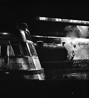 Steel Thunderbolts: A Steam and a diesel engine at the Union Station yards in Chicago, Illinois. January 1943.<br /> <br /> Photo by Jack Delano.
