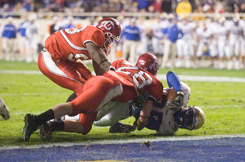 23 December 2006: Tulsa running back Tarrion Adams (#25) dives just short of the goal line during the 2006 Bell Helicopters Armed Forces Bowl between The University of Tulsa and The University of Utah at Amon G. Carter Stadium in Fort Worth, TX.