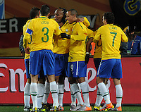 Brazil defender Maicon and teammates celebrate his goal, which gave his team a 1-0 lead in the 55th minute against North Korea.Brazil defeated North Korea, 2-1, in both teams' opening match of play in Group G of the 2010 FIFA World Cup. The match was played at Ellis Park in Johannesburg, South Africa June 15th.