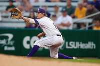 LSU Tigers first baseman Mason Katz #8 stretches for a throw against the Mississippi State Bulldogs during the NCAA baseball game on March 16, 2012 at Alex Box Stadium in Baton Rouge, Louisiana. LSU defeated Mississippi State 3-2 in 10 innings. (Andrew Woolley / Four Seam Images)