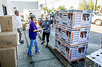 MARIANNA, FL - OCTOBER 13: Wendy Welch, center, helps Marla Whitaker and her family with one of the shipment of generators and chain saws that arrived after Hurricane Michael on October 13, 2018 in Marianna, Florida. (Photo by Mark Wallheiser/Getty Images)