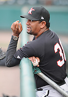 Pitching coach Jose Batista (38) of the Kannapolis Intimidators, Class A affiliate of the Chicago White Sox, prior to a game against the Greenville Drive on May 26, 2011, at Fluor Field at the West End in Greenville, S.C. The game was postponed due to rain. Photo by Tom Priddy / Four Seam Images