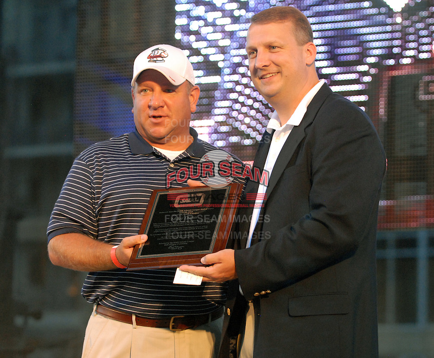 Rome Braves general manager Mike Dunn takes his Hall of Fame plaque from league president Eric Krupa at the 2010 South Atlantic League All-Star Game welcome party and festivities Monday night June 21, 2010, at the Wyche Pavilion along the Reedy River in Greenville, S.C. Photo by: Tom Priddy/Four Seam Images