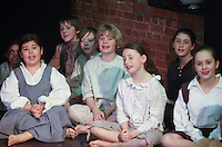 "Performing on stage.  Drama group for 8-13s rehearsing a production of ""Alice"" in the Mill Studio at the Yvonne Arnaud Theatre, Guildford, Surrey."