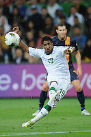 Salem AL DAWSARI (19) of Saudi Arabia kicks the ball during the FIFA 2014 World Cup Group D Asian Qualifier match between Australia and Saudi Arabia at AAMI Park in Melbourne, Australia...This image is not for sale on this web site. Please contact Southcreek Global Media for licensing:.Toll Free: 1.800.934.5030.Canada: 701 Rossland Rd. East, Suite 315, Whitby, Ontario, Canada, L1N 9K3.USA: 10792 Baron Dr, Parma OH, USA 44130.Web: http://southcreekglobal.net/ and http://southcreekglobal.com/