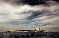 A sailor's view of Beavertail Lighthouse resting in the north.