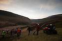 10/05/16 <br /> <br /> Game keepers, Park Rangers and members of The National Trust survey the hills for signs of new smoke shortly after sun down.<br /> <br /> Full story:   http://www.fstoppress.com/articles/peak-district-fire/<br /> <br /> .A small group of gamekeepers spent the night fighting a major blaze blaze covering two hundred acres of heather moorland close to the Derwent and Ladybower reservoirs in the Derbyshire Peak District.<br /> <br /> The fire, which broke out at around 1pm on Monday, is believed to have been started by a disposable barbecue, according to a spokesman for the reservoir, which quickly escalated into a major fire threatening the natural habitat of many wild animals and birds including red grouse, plovers, meadow pipits and hen harriers.<br /> <br /> Ten fire crews were called to tackle the flames, and remained on scene until dusk fell, leaving the job of managing the fire overnight to the gamekeepers on scene.<br /> <br /> Kieran Logan was one of the gamekeepers left battling the flames and he said moorland management policies implemented some 10 years ago by the landowners, The National Trust were also partly to blame.<br /> <br /> All Rights Reserved: F Stop Press Ltd. +44(0)1335 418365   +44 (0)7765 242650 www.fstoppress.com