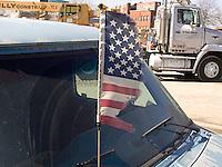 Torn American flag on car antenna<br />