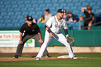 Syracuse Chiefs first baseman Matt Skole (16) in position as umpire Jonathan Bailey looks on during a game against the Louisville Bats on June 6, 2016 at NBT Bank Stadium in Syracuse, New York.  Syracuse defeated Louisville 3-1.  (Mike Janes/Four Seam Images)