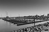 Empty boat slips outnumber those with moored boats more than 10 to one in a section of the San Leandro Marina in this black and white image taken May 3, 2021.