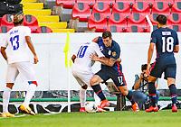 GUADALAJARA, MEXICO - MARCH 28: Rigoberto Rivas #10 of Honduras battles with Aaron Herrera #17 of the United States during a game between Honduras and USMNT U-23 at Estadio Jalisco on March 28, 2021 in Guadalajara, Mexico.