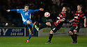 Queen of the South's Daniel Carmichael and Ayr Utd's David Sinclair challenge for the ball.