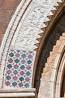 13th century Romanesque inlaid mosaics and decorative marble archivolt of the main portal with decorative marble relief sculptures of the signs of the Zodiac and the work of the seasons on the 8th century Romanesque Basilica church of St Peters, Tuscania, Lazio, Italy