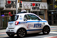 """NEW YORK, NEW YORK - SEPTEMBER 3: A NYPD car patrols at Times Square on September 3, 2020 in New York. U.S. President Trump has ordered to the federal government to begin the process to defund NYC and three other cities where protest """"lawless"""" were allowed and police budgets were cut, rising violent crime. (Photo by Eduardo MunozAlvarez/VIEWpress via GettyImages)"""