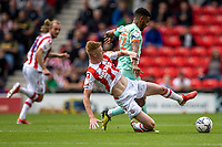 11th September 2021;  Bet365 Stadium, Stoke, Staffordshire, England; EFL Championship football, Stoke City versus Huddersfield Town; Sam Clucas of Stoke City tackles Fraizer Campbell of Huddersfield Town Strictly Editorial Use Only. No use with unauthorized audio, video, data, fixture lists, club/league logos or 'live' services. Online in-match use limited to 120 images, no video emulation. No use in betting, games or single club/league/player publications